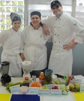 CulinaryCorps chefs with their vegetables on display